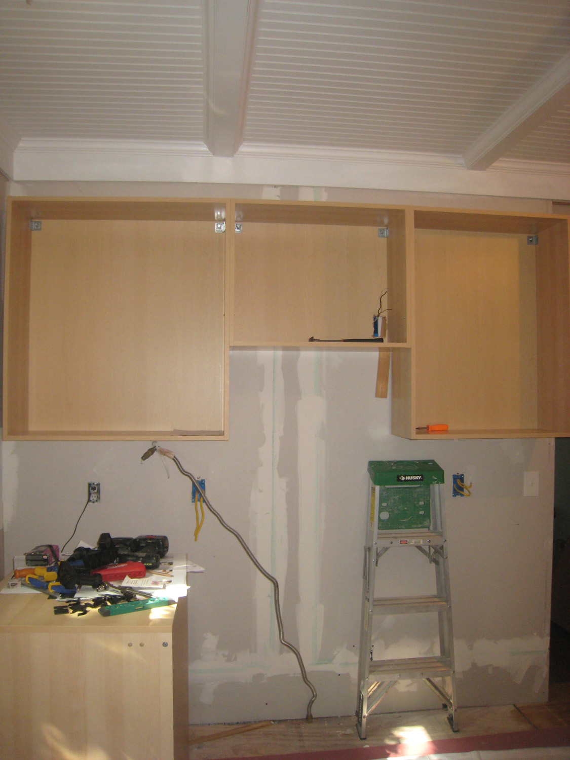 North Wall W/ Upper Cabinets Installed (microwave To Be Installed Below  Middle Cabinet)