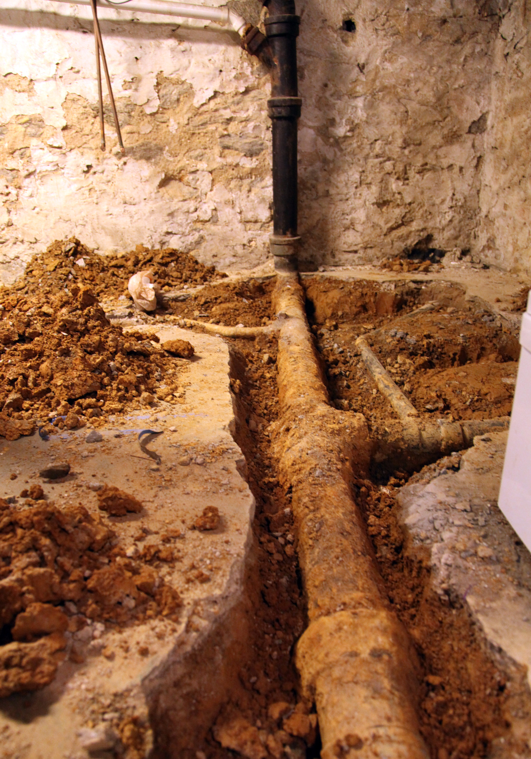 Cast ... & Our Basement Part 8: Digging out for the Basement Plumbing | Stately ...