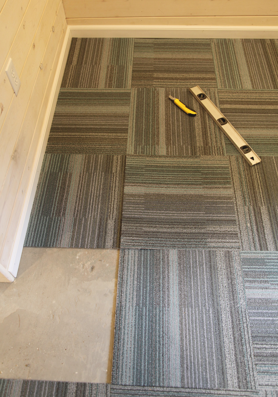 how to install carpet tiles in basement